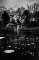 A black and white image of the Mabry Mill and the pond in front of it.