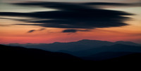Long exposure of moving clouds over blue ridge mountains.