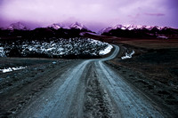 A color enhanced image of the road leading into the crazy mountains.
