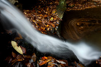 Long exposure of Gully Creek. Leaves in a swirl.