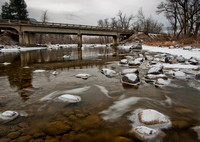 A bridge crossing a frozen Stillwater River near Nye.
