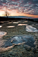 Water puddles on Billings' rimrocks at sunrise