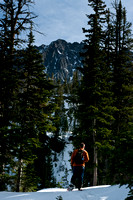 Snow shoe hiker in the Crazy Mountains near Blue Lake