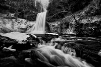 A black and white winter image of the Cascades waterfall near Pembroke, VA.